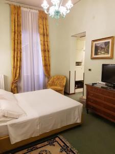 Een bed of bedden in een kamer bij Hotel Bonvecchiati