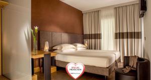Cama ou camas em um quarto em Best Western Plus Hotel Spring House