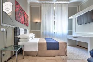 Letto o letti in una camera di Ramé Suites