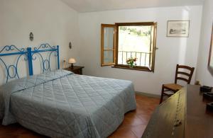 Letto o letti in una camera di Casa Vacanze Villa Giusterna