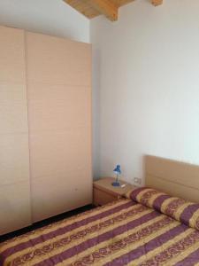 Postel nebo postele na pokoji v ubytování Residence Antares