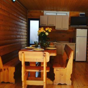 Кухня или мини-кухня в Гoстевой комплекс АрНа
