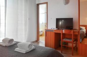 A television and/or entertainment center at Hotel Keltika