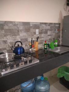 Una cocina o zona de cocina en AMBAR Rooms & Coffee