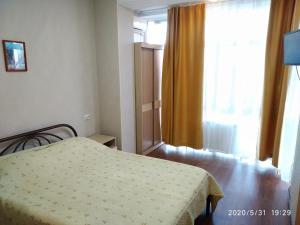 Кровать или кровати в номере Apartment in Dzhemete