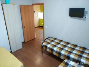 Телевизор и/или развлекательный центр в Apartment in Dzhemete