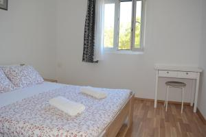 A bed or beds in a room at Apartments Rotim