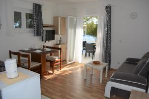 A kitchen or kitchenette at Apartments Rotim