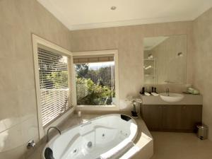 A bathroom at Delderfield Cottages