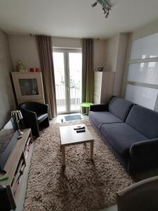 A seating area at Apartment Franky