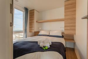 Letto o letti in una camera di AQUA RESORT GIULIANOVA - Houseboat