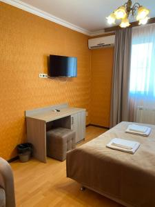 A television and/or entertainment center at On Ivoviy Guest House