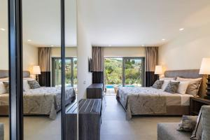 A bed or beds in a room at Rodostamo Hotel & Spa- Adults Friendly