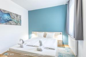 Cama o camas de una habitación en Corvin Plaza Apartments & Suites