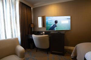 A television and/or entertainment center at Best Western Plus City Centre Hotel Den Bosch