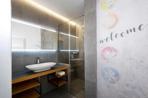 Ein Badezimmer in der Unterkunft Hotel Vierjahreszeiten