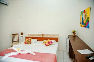 A bed or beds in a room at Hotel Mare Mansa