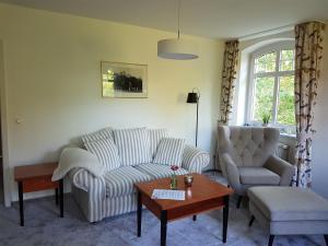 Ein Sitzbereich in der Unterkunft Ringhotel Villa Margarete
