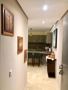 A kitchen or kitchenette at Sunshine Apartment Marrakech
