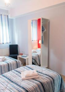 A bed or beds in a room at Ośrodek Wypoczynkowy Żagiel
