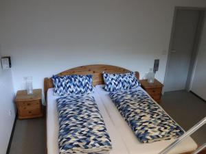 Ein Bett oder Betten in einem Zimmer der Unterkunft Haus Höhneck 1