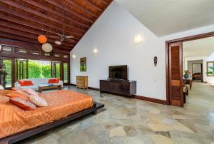 A seating area at Unique Villa with Ocean and River Views - Staff & Golf Carts
