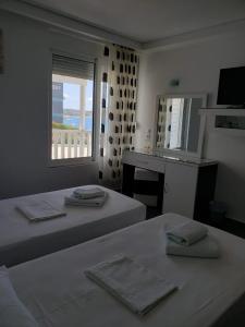 Postelja oz. postelje v sobi nastanitve Barracuda Hotel