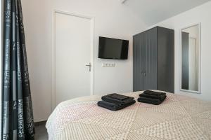 Een bed of bedden in een kamer bij Wijngaardstraat 12