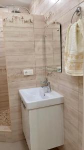 A bathroom at Апартаменты У моря для семьи