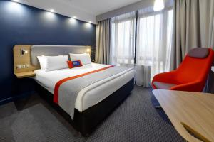 A bed or beds in a room at Holiday Inn Express Moscow - Khovrino, an IHG Hotel