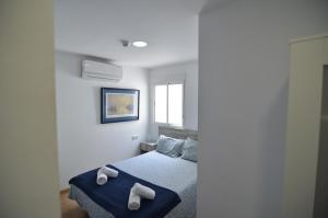 Cama o camas de una habitación en Hotel Boutique Nomadas