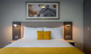 A bed or beds in a room at Maldron Hotel Sandy Road Galway