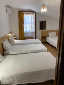 A bed or beds in a room at Guesthouse Lusa Atenas