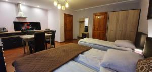 Łóżko lub łóżka w pokoju w obiekcie Aspen