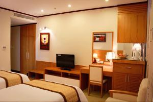 A television and/or entertainment centre at Danang Petro Hotel