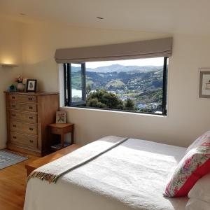 A bed or beds in a room at The Rectangle Apartment, Akaroa