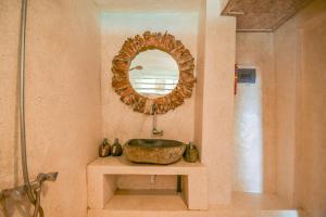 A bathroom at Le Cliff Bali