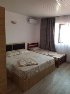 A bed or beds in a room at Vila Dan