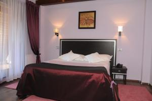 A bed or beds in a room at Casa Freya