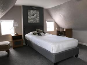 A bed or beds in a room at Bridgemary Manor Hotel & Pub