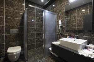 Ванная комната в Euphoria Apartments & Residence