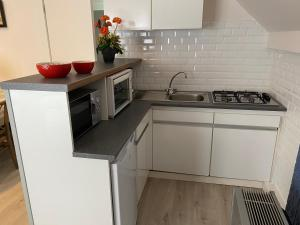 A kitchen or kitchenette at Apartment Van Hecke