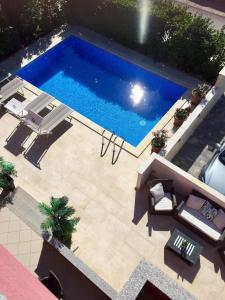 A view of the pool at Apartments Mare or nearby