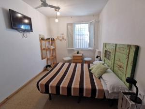 Cama o camas de una habitación en Mucha Masia Hostel Rural Urba