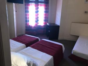 A bed or beds in a room at Hôtel Savoy