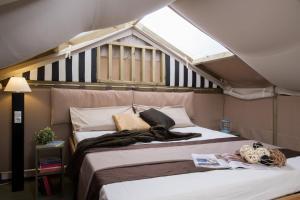 Postel nebo postele na pokoji v ubytování Camping Laguna Village