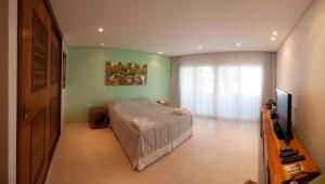 Cama ou camas em um quarto em Juquehy La Plage Hotel
