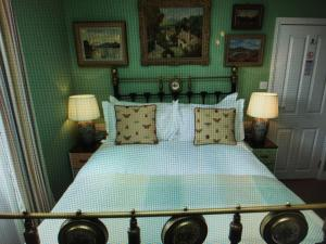A bed or beds in a room at The Royal Harbour Hotel