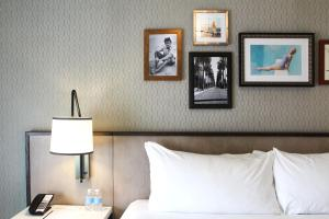 A bed or beds in a room at La Valencia Hotel
