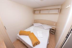 Postelja oz. postelje v sobi nastanitve Mobile Homes Camp Klenovica